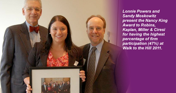 Robins Kaplan accept EJC award from Lonnie Powers and Sandy Moskowitz